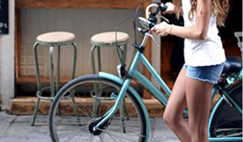 girl with bike alongside